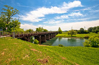 Korana river landscape in Karlovac, green landscape and bridge