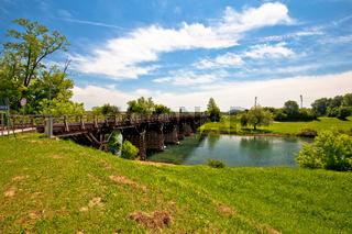 Korana river landscape in Karlovac, green landscape and bridge