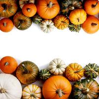 Autumn frame of pumpkins on white
