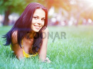 sexy brunette on grass