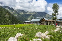 Wooden houses and mountain backdrop, Chitkul Valley, , Himachal Pradesh, India