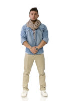 Handsome young man standing with denim shirt and scarf