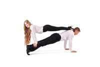 Businessman and businesswoman doing acrobatic plank trick together