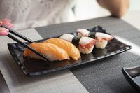Four japanese nigiri sushi with salmon and sushi with octopus