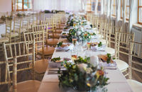 Tables with decoration and plates ready at wedding reception, shallow depth of field photo