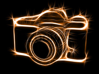 Abstract sparkling silhouette of photocamera. High resolution 3D image