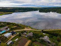 Amazing landscape of calm lake near village