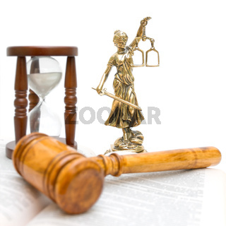 statue of justice, gavel, law book and hourglass