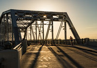Runner on John Seigenthaler pedestrian bridge or Shelby street crossing at sunrise in Nashville