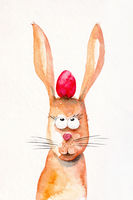 easter rabbit with a red egg between the ears watercolor paint
