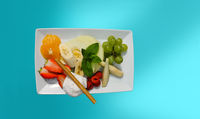 Dessert on white plate with green background. copy space.