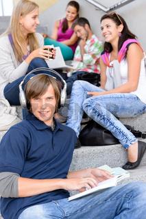 Students sitting on high-school stairs in break
