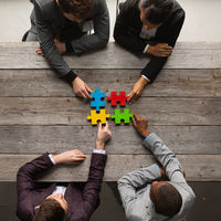 Business teamwork with color puzzle