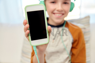 boy with headphones and smartphone at home