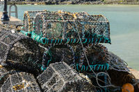 ST IVES, CORNWALL, UK - MAY 13 : Lobster pots on the quayside at St Ives, Cornwall on May 13, 2021
