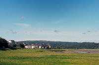 view of the village of arnside from the bank of the river kent with surrounding countryside