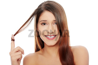 Beautiful caucasian woman with healthy long hairs