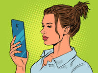A woman looks at a smartphone. Internet communication, gadgets and technologies