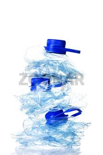 Squashed empty used plastic bottles
