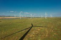 Windmills or wind turbine and shadow