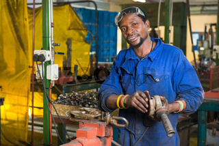 A service repairmen labouring in workshop during his shift
