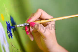 Close-up Shot of Female Artist Hand, Holding Paint Brush and Drawing Oil Painting. Contemporary Painter Creating Modern Abstract Piece of Fine Art.