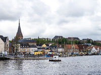 Sail boats in the port of Flensburg, St. Jorgen's Church in the background. Schleswig-Holstein in Germany
