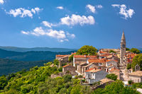 Idyllic hill town of Draguc in green landscape view