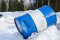 Image of striped barrel on snow in forest