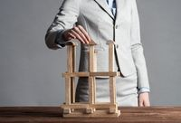 Business woman building construction on table