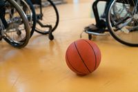 a photo of the wheelchair, wheelchair equipment and ball located in the arena before the game