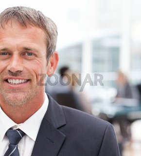 Smiling businessman in his office