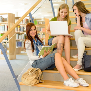 Group of high school classmates study library