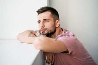 Fashion style portrait of handsome sexy man on white background.