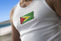 The national flag of Guyana on the athlete's chest