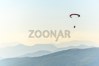 Paragliding flight in the air over the mountains.