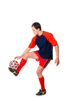 football player in red clothes showing trick with ball