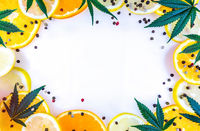 Cannabis Terpene concept with leafs lemons orange and peppercorns on white background copy space
