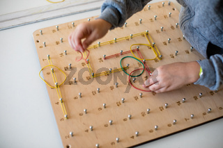 Exploring basic math and geometry concepts with geoboard