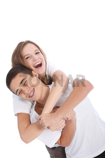 Laughing teenage brother and sister