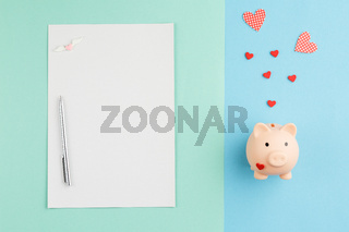 Piggy bank with heart charity concept.