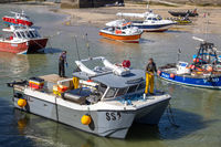 ST IVES, CORNWALL, UK - MAY 13 : View of a fishing boat at St Ives, Cornwall on May 13, 2021. Two unidentified people