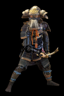 Japanese Samurai in armor standing isolated on white background. Traditional japan warrior armour