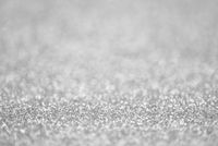 Texture of light silver glitter dust surface, luxury background with bokeh