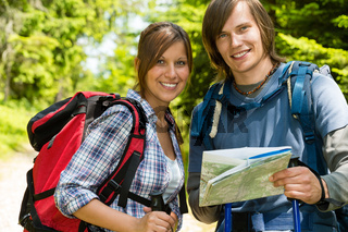 Portrait of trekking couple checking the map