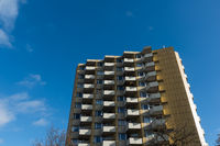A multi-storey house with a blue sky