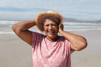 Portrait of senior african american woman smiling on the beach