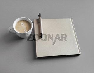Booklet, coffee, pen