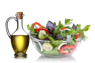 Salad and oil isolated on white