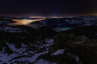 night snowy valley with fog and stars